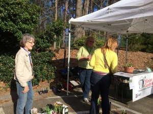 Marsha answering questions at Spring plant sale with Susanna looking on